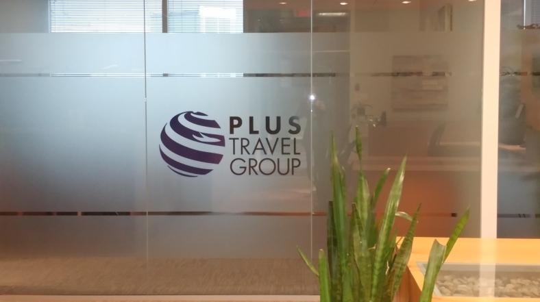 Plus Travel Group Window Signage